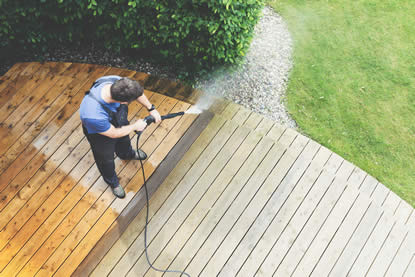 Pressure washing deck to original luster
